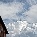 Barn And Clouds by Joseph J Stevens