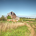 Barn In A Field With Hay Bales by Larry Braun