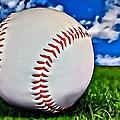 Baseball In The Grass by Florian Rodarte