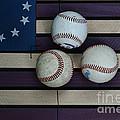 Baseballs On American Flag Folkart by Paul Ward