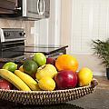 Basket Of Fresh Fruit In Modern Kitchen by Joe Belanger