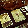 Battered Suitcase Of Antique Photographs by Amy Cicconi