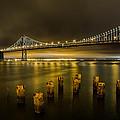 Bay Bridge And Clouds At Night by John Daly