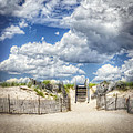 Beach Clouds And Fence by Vicki Jauron
