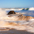 Beach Waves Smoothly Flowing Over The Rocks Fine Art Photography Print by Jerry Cowart