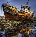 Beached Fishing Trawler Reflecting While Waiting For The Tide by Dennis Dame