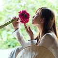 Beautiful Asian Woman With Flowers - Vietnam by Matteo Colombo