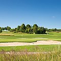 Beautiful Green Golf Course And Blue Sky by Matthias Hauser