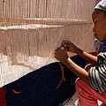 Berber Girl Working On Traditional Berber Rug Ait Benhaddou Southern Morocco by Ralph A  Ledergerber-Photography
