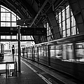 Berlin S-bahn Train Speeds Past Platform At Alexanderplatz Main Train Station Germany by Joe Fox