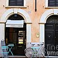 Bicycle With Blue Table And Chairs In Roma by Julia Willard