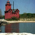 Big Red Holland Michigan Lighthouse by Michelle Calkins