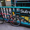Bike At Subway Entrance by Garry Gay