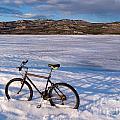 Bike On Frozen Lake Laberge Yukon Canada by Stephan Pietzko