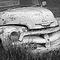 Black And White Photograph A Vintage Junk Chevy Pickup Truck by Randall Nyhof