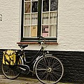 Black Cycle Rests On Window Sill Bruges Belgium by Imran Ahmed