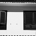 black painted sun shutter blinds on windows of white washed house in tacoronte Tenerife Canary Islands Spain by Joe Fox