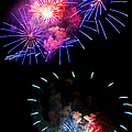Blue And Red Firework Disks by Weston Westmoreland