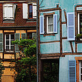 Blue And Yellow Buildings In La Petite Venise In Colmar France by Greg Matchick