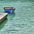 Blue Boat Off Dock by Michael Thomas