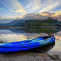 Blue Canoe At Sunset by Debra and Dave Vanderlaan