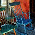 Blue Chair Against Red Door by Susan Savad