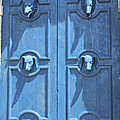 Blue Door Decorated With Wooden Animal Heads by Christiane Schulze Art And Photography