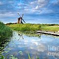 Blue Sky And Windmill Reflected In River by Olha Rohulya