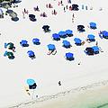 Blue Umbrellas On A Sunny Beach by Tommy Clarke