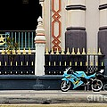 Blue Yellow Sporty Motorcycle Parked On Pavement by Imran Ahmed