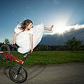 Bmx Flatland Rider Monika Hinz Jumps In Wedding Dress by Matthias Hauser