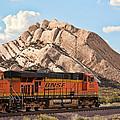 Bnsf Past Mormon Rocks by Peter Tellone