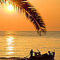 Boat At Sea Sunset Golden Color With Palm by Raimond Klavins