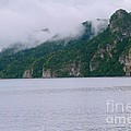 Boat In The Mist by Robert Nickologianis
