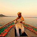 Boat Man On The Ganges River At Varanasi by Amanda Stadther