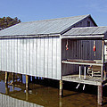 Boathouse At Low Tide by David Nichols