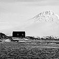 boathouse on goudier island port lockroy with doumer island hill Antarctica by Joe Fox