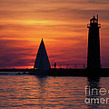 Boats Entering The Channel At The Muskegon Lighthouse by John Harmon