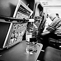 Bottle Of Water On Tray Table Interior Of Jet2 Aircraft Passenger Cabin In Flight Europe by Joe Fox