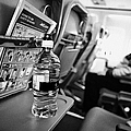 Bottle Of Water On Tray Table Interior Of Jet2 Aircraft Passenger Cabin In Flight by Joe Fox