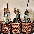 Bottles In Baskets by Eduardo Palazuelos Romo