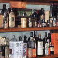 Bottles In General Store by Susan Savad