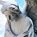 Bowing Male Angel With Blue Sky And Clouds by Sally Rockefeller