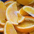Bowl Of Sliced Oranges by Debra Baldwin
