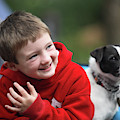 Boy, Age 6, Smiling With Jack Russell by Chris Butler