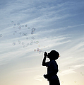 Boy Blowing Bubbles by Tim Gainey
