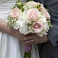 Bride And Groom Hold Wedding Bouquet by Lee Avison