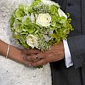 Bride And Groom With Wedding Bouquet by Lee Avison