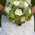 Bride Holding A Wedding Bouquet by Lee Avison