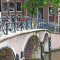 Bridge Over Canal With Bicycles  In Amsterdam by Jaroslav Frank